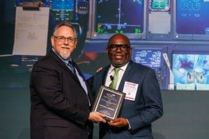 Kevin Mitchell, Sector Vice President, Global Operations, Northrop Grumman Aerospace Systems, accepts SME's 2019 Excellence in Composites Manufacturing Award (Large Company).